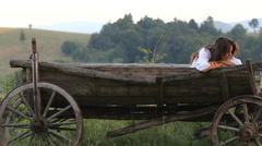 Melancholic young woman rest in traditional wooden cart  Stock Footage