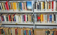 public library with many books to borrow - stock photo