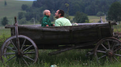 Stock Video Footage of Loving and funny day, baby boy and father touch the nose in traditional cart