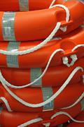 Piles of orange life preserver for help to people in danger of drowning Stock Photos