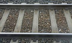 Train track with sleepers and rails where stones passing freight train Stock Photos