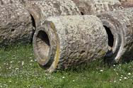 Stock Photo of stone and trachyte tubes of an ancient roman aqueduct historical artifact
