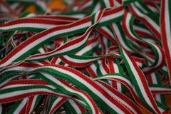 Many italian flag use tape to secure the medals of athletes Stock Photos