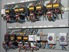 Fuses and switches ammeters and measuring instruments in an industrial electr Stock Photos