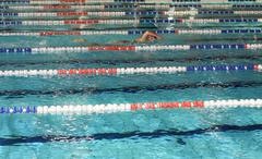 Swimmer he trains in the olympic pool ahead of competition Stock Photos