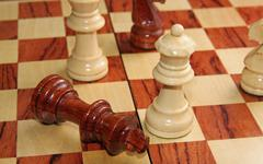 Checkmate with the king threw and the white queen who wins Stock Photos