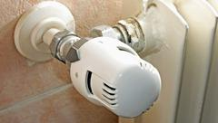 thermostatic valve of the heater at home to save gas - stock photo