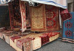 street big stall with resale of ancient persian carpets - stock photo