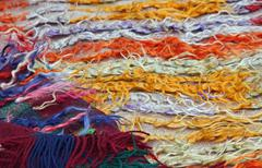 Wires and strings of a wool sweater for sale at the market Stock Photos