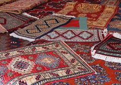 Textures and background of ancient handmade carpets Stock Photos