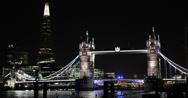 Ultra HD 4K UK Ambulance Car Passing Tower Bridge Illuminated London Shard Night Stock Footage