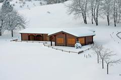 wooden mountain chalet in the alps in italy - stock photo