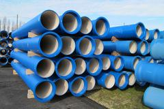 concrete pipes for transporting water and sewerage - stock photo