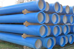 piles of concrete pipes for transporting  sewerage - stock photo