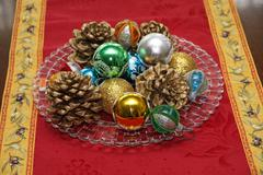 Red carpet with a nice christmas decor with pine cones and shimmering balls Stock Photos