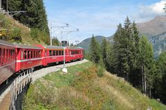 Red train around the beautiful swiss mountains 19 Stock Photos