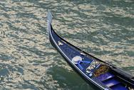 Stock Photo of tip of a feature gondola boat in the lagoon city of venice