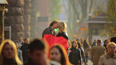 The lovers with heart-like umbrella above the people crowd, SLOW MOTION Stock Footage