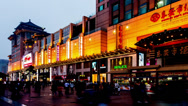 Stock Video Footage of The customers roam in Wangfujing Avenue at evening in Beijing, China