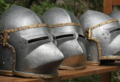 Medieval helmets of ancient a mighty iron armor used by the knights templar Stock Photos