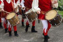 Drums and musicians with ancient medieval costumes during the parade in the v Stock Photos