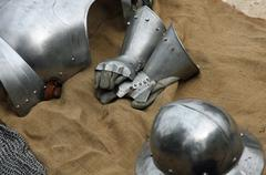 gloves and metal armor with a helmet during the medieval spectacle - stock photo