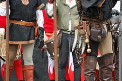 Leather pants with medieval accessories during the medieval spectacle Stock Photos