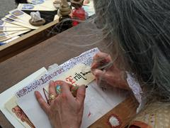 Elderly writer decorator than a sheet with a name written in ancient gothic c Stock Photos