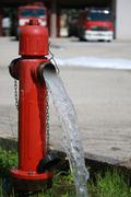 powerful water flow coming out with impetus from a street red hydrant - stock photo