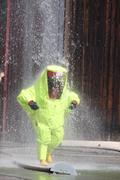 fireman with a suit for protection in the midst of malicious foaming white - stock photo