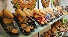 summer sandals with the toes of dummies for sale in artisanal italian shoe co - stock photo