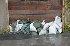 Sandbags to protect against flooding of the river during the flood Stock Photos