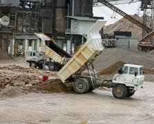 Huge truck with tipper in a open pit mine in an industrial area Stock Photos