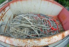 Container full of copper electrical cables in a municipal landfill Stock Photos