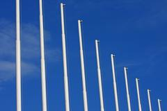 vertical row of flagship auctions without flags and the blue sky - stock photo