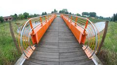Pedestrian bridge and bike trail over the river Stock Photos