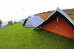 lined tents in a scout camp open air in the middle of nature - stock photo