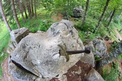 legendary and famous sword excalibur to king stuck between the rock - stock photo