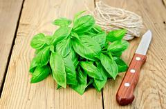 basil green beam with twine - stock photo
