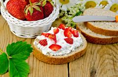 bread with curd cream and strawberries with a basket - stock photo