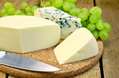 Cheese blue and suluguni on the board Stock Photos