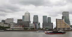 Ultra HD 4K Facade Canary Wharf Skyline Thames River London Tour Boat Passing Stock Footage
