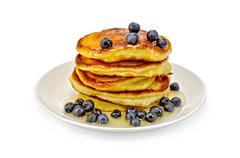 flapjacks with blueberries and honey - stock photo