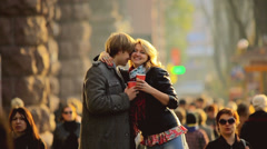 The young lovers with tea cups above the people crowd, REAL TIME Stock Footage