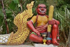 Punainen demoni huoltajan Phra That Doi Toung temppeli Kuvituskuvat