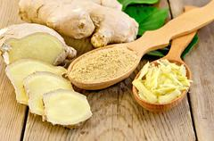 ginger powder and grated in the spoon with the root and leaves - stock photo