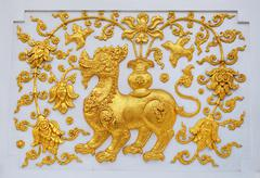 singa in traditional thai style molding art. - stock photo