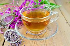 Herbal tea from fireweed in a glass cup with strainer Stock Photos