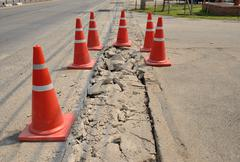 Stock Photo of traffic cone  used on concrete pavement .