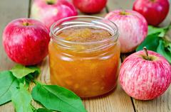 jam apple with apples and leaves on the board - stock photo